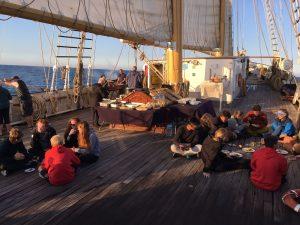 Photo of Santa Maria Manuela trainees enjoying their meal on deck