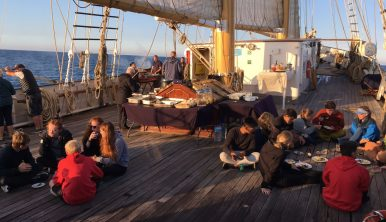 Photo of Santa Maria Manuela trainees enjoying their meal on deck